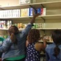 5 women checking food stock